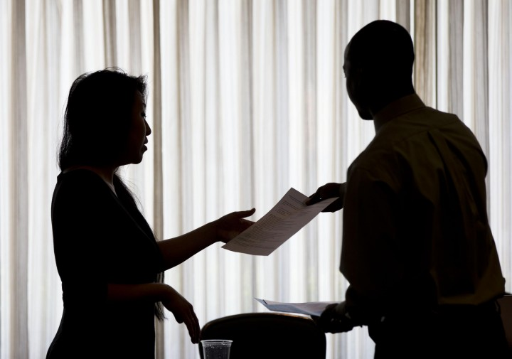 Applications for US jobless aid barely rose last week