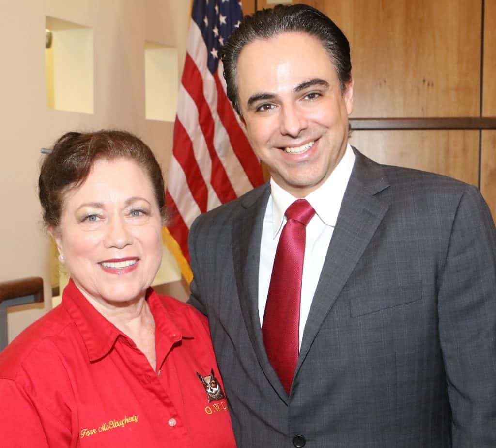 Featured: Fern McClaugherty, a leader with O.W.L.S. (Objective Watchers of the Legal System), with Rep. Terry Canales, D-Edinburg, in the Edinburg City Council Chamber at Edinburg City Hall on Thursday, February 14, 2019, during a reception hosted by the City of Edinburg to honor Canales for his appointment as Chair, House Committee on Transportation.  Photograph by MARK MONTEMAYOR